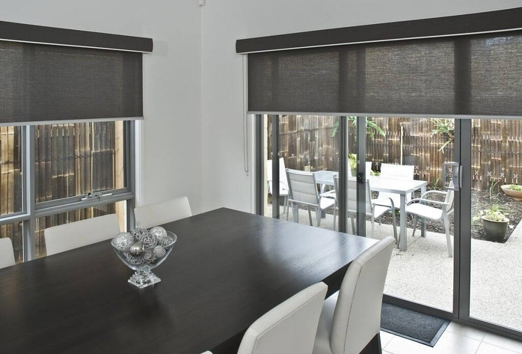 Dining area with black roller blinds with view to outdoor dining