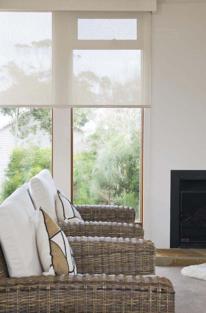 white roller blinds view from behind chairs